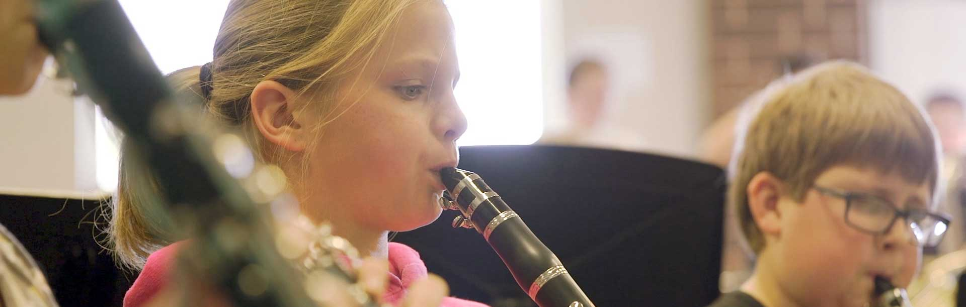 Student Playing Clarinet in Band Class